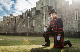 A Yeoman Warder plants the first poppy at the Tower