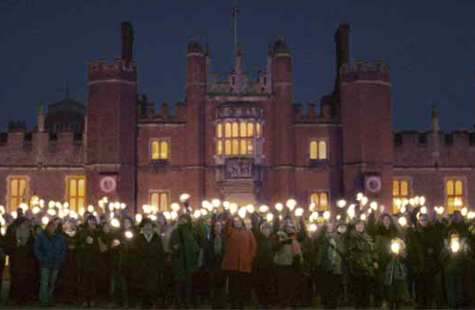 Volunteers outside Hampton Court Palace to celebrate the 500 year anniversary of the palace