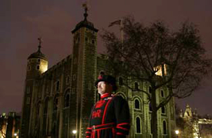 Yeoman outside the White Tower at night