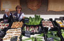 Volunteers sell vegetables at Hampton Court Palace