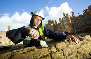 An archaeologist working in Base Court at Hampton Court Palace