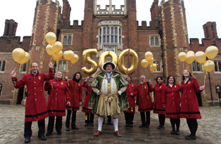 A character actor playing Henry VIII and Historic Royal Palace staff celebrate the 500 anniversary of Hampton Court Palace