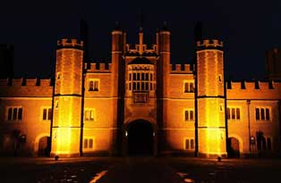 The west front of Hampton Court Palace lit up at night