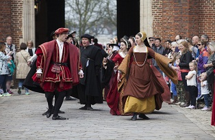 The opening procession on 2015 Time plays, Tudor man in Red costume, Tudor lady and other cast members behind.