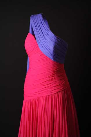 A fuchsia and purple sari style dress (lent by the Museo de la Mode)