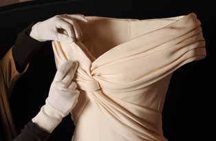 An ivory coloured formal dinner dress (lent by the Museo de la Moda)