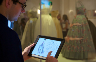 Fashion Rules on Paper - image of illustration app being used to draw dresses in the exhibition