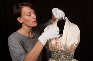 Preparing a dress worn by Princess Margaret for display