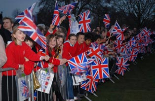 Children with flags outside Kew Palace