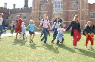 Children playing outside Hampton Court Palace
