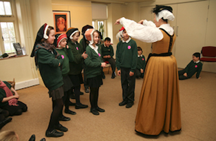 Pupils dressed in Tudor hats