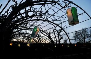 Lanterns from the 'Into the light' project hanging from an arbour at the palace