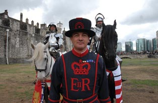 A Yeoman Warder with two knights on horseback, at the Tower of London