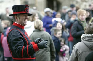 A Yeoman Warder with a group of tourists