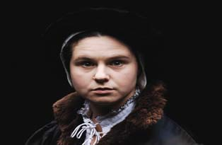 A costumed guide dressed as Anne Askew at the Tower of London