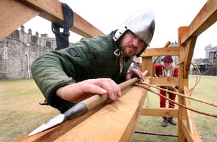 Men using the springald