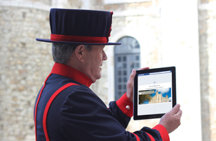 Beefeater inspects Tower of London's 1,000 year Facebook timeline on iPad