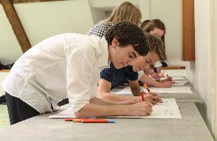 GCSE students writing